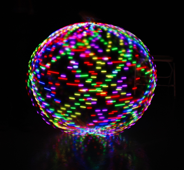 An LED hula hoop twirled to create a ball of light