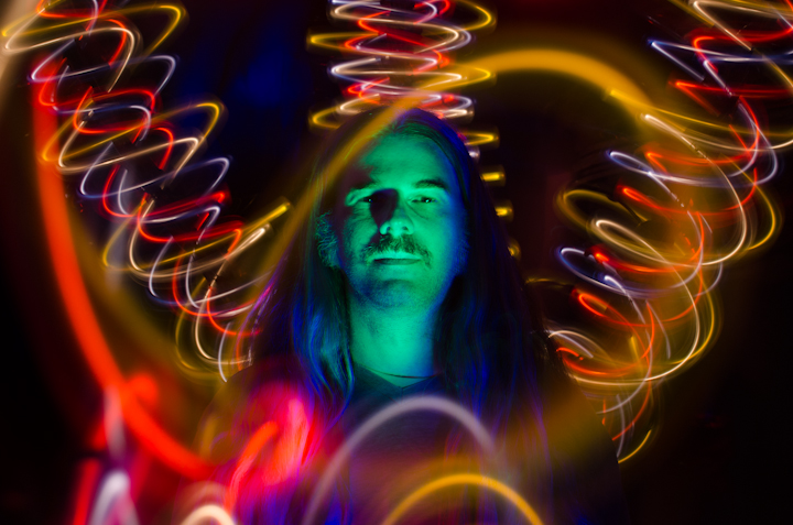 A light painted portrait of a man with swirling lights