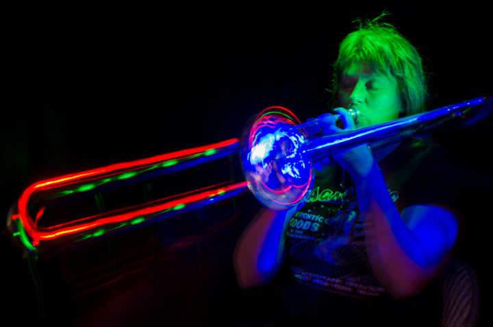 A light painted women playing trombone