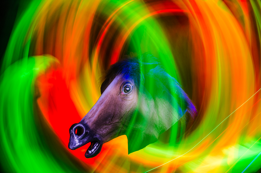 A blur of colors surrounding a horse's head